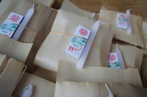 a bamboo-sheath-like package of offerings